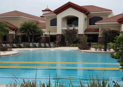Versatile resort pool provides areas to lounge or swim laps Resort pool and clubhouse